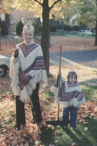 Jenn, Mom raking leaves matching ponchos pic